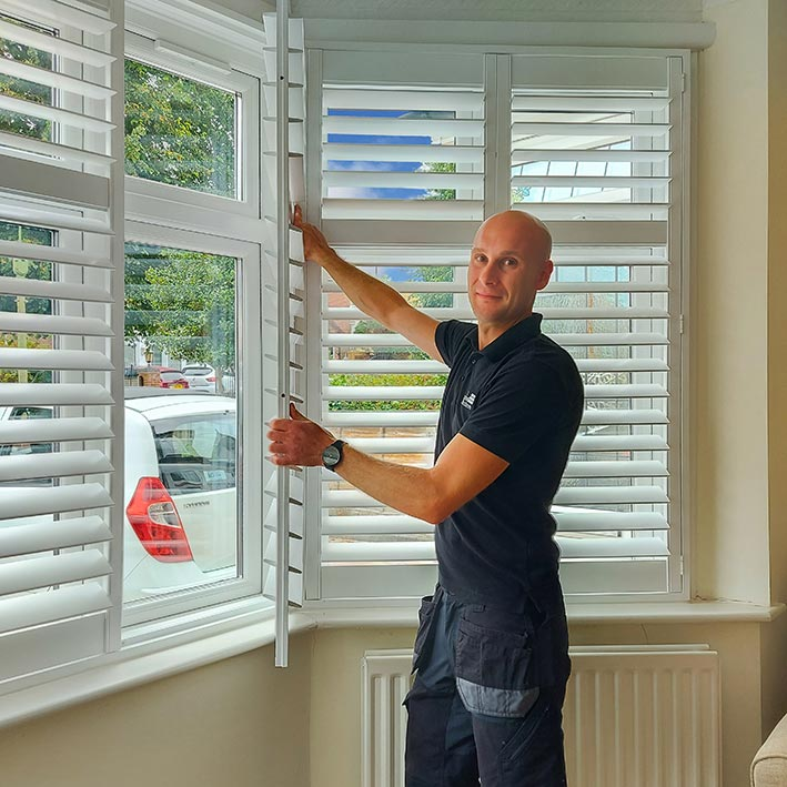 Business Owner Fitting Shutters